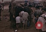 Image of American soldiers search a Japanese youth in uniform Saipan Northern Mariana Islands, 1944, second 31 stock footage video 65675050873