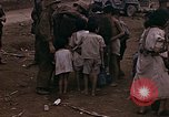 Image of American soldiers search a Japanese youth in uniform Saipan Northern Mariana Islands, 1944, second 32 stock footage video 65675050873