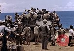 Image of American soldiers search a Japanese youth in uniform Saipan Northern Mariana Islands, 1944, second 37 stock footage video 65675050873