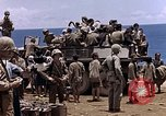 Image of American soldiers search a Japanese youth in uniform Saipan Northern Mariana Islands, 1944, second 38 stock footage video 65675050873