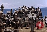 Image of American soldiers search a Japanese youth in uniform Saipan Northern Mariana Islands, 1944, second 40 stock footage video 65675050873