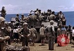 Image of American soldiers search a Japanese youth in uniform Saipan Northern Mariana Islands, 1944, second 41 stock footage video 65675050873