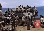 Image of American soldiers search a Japanese youth in uniform Saipan Northern Mariana Islands, 1944, second 43 stock footage video 65675050873