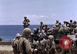 Image of American soldiers search a Japanese youth in uniform Saipan Northern Mariana Islands, 1944, second 46 stock footage video 65675050873