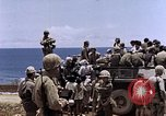 Image of American soldiers search a Japanese youth in uniform Saipan Northern Mariana Islands, 1944, second 47 stock footage video 65675050873