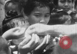 Image of natives Burma, 1943, second 32 stock footage video 65675050905