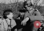 Image of German soldiers greeted by Austrians during Anschluss Austria, 1938, second 2 stock footage video 65675050939