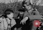 Image of German soldiers greeted by Austrians during Anschluss Austria, 1938, second 4 stock footage video 65675050939