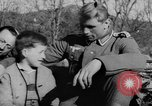 Image of German soldiers greeted by Austrians during Anschluss Austria, 1938, second 5 stock footage video 65675050939