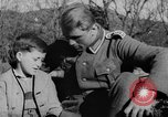 Image of German soldiers greeted by Austrians during Anschluss Austria, 1938, second 8 stock footage video 65675050939