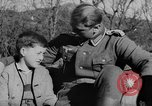 Image of German soldiers greeted by Austrians during Anschluss Austria, 1938, second 9 stock footage video 65675050939