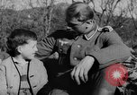 Image of German soldiers greeted by Austrians during Anschluss Austria, 1938, second 12 stock footage video 65675050939