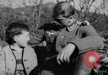 Image of German soldiers greeted by Austrians during Anschluss Austria, 1938, second 16 stock footage video 65675050939