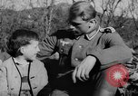Image of German soldiers greeted by Austrians during Anschluss Austria, 1938, second 18 stock footage video 65675050939