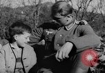Image of German soldiers greeted by Austrians during Anschluss Austria, 1938, second 19 stock footage video 65675050939