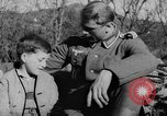 Image of German soldiers greeted by Austrians during Anschluss Austria, 1938, second 20 stock footage video 65675050939