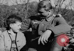 Image of German soldiers greeted by Austrians during Anschluss Austria, 1938, second 21 stock footage video 65675050939