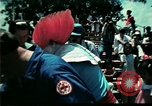 Image of Clown entertains Vietnamese refugee children Florida United States USA, 1975, second 11 stock footage video 65675050952