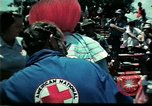 Image of Clown entertains Vietnamese refugee children Florida United States USA, 1975, second 15 stock footage video 65675050952