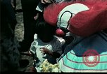 Image of Clown entertains Vietnamese refugee children Florida United States USA, 1975, second 20 stock footage video 65675050952
