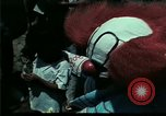 Image of Clown entertains Vietnamese refugee children Florida United States USA, 1975, second 21 stock footage video 65675050952