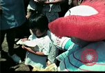Image of Clown entertains Vietnamese refugee children Florida United States USA, 1975, second 22 stock footage video 65675050952