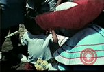 Image of Clown entertains Vietnamese refugee children Florida United States USA, 1975, second 24 stock footage video 65675050952