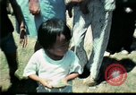 Image of Clown entertains Vietnamese refugee children Florida United States USA, 1975, second 26 stock footage video 65675050952