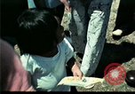 Image of Clown entertains Vietnamese refugee children Florida United States USA, 1975, second 27 stock footage video 65675050952