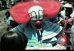 Image of Clown entertains Vietnamese refugee children Florida United States USA, 1975, second 31 stock footage video 65675050952