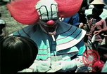 Image of Clown entertains Vietnamese refugee children Florida United States USA, 1975, second 33 stock footage video 65675050952