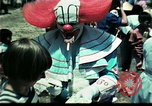 Image of Clown entertains Vietnamese refugee children Florida United States USA, 1975, second 36 stock footage video 65675050952