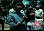 Image of Clown entertains Vietnamese refugee children Florida United States USA, 1975, second 38 stock footage video 65675050952