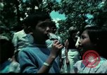Image of Clown entertains Vietnamese refugee children Florida United States USA, 1975, second 39 stock footage video 65675050952