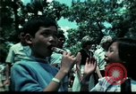 Image of Clown entertains Vietnamese refugee children Florida United States USA, 1975, second 40 stock footage video 65675050952