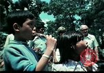 Image of Clown entertains Vietnamese refugee children Florida United States USA, 1975, second 42 stock footage video 65675050952