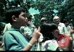 Image of Clown entertains Vietnamese refugee children Florida United States USA, 1975, second 43 stock footage video 65675050952