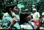 Image of Clown entertains Vietnamese refugee children Florida United States USA, 1975, second 44 stock footage video 65675050952