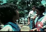 Image of Clown entertains Vietnamese refugee children Florida United States USA, 1975, second 51 stock footage video 65675050952