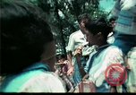 Image of Clown entertains Vietnamese refugee children Florida United States USA, 1975, second 52 stock footage video 65675050952