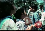 Image of Clown entertains Vietnamese refugee children Florida United States USA, 1975, second 53 stock footage video 65675050952