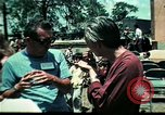Image of Clown entertains Vietnamese refugee children Florida United States USA, 1975, second 55 stock footage video 65675050952