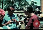 Image of Clown entertains Vietnamese refugee children Florida United States USA, 1975, second 56 stock footage video 65675050952