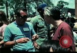 Image of Clown entertains Vietnamese refugee children Florida United States USA, 1975, second 58 stock footage video 65675050952