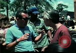 Image of Clown entertains Vietnamese refugee children Florida United States USA, 1975, second 60 stock footage video 65675050952