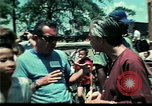 Image of Clown entertains Vietnamese refugee children Florida United States USA, 1975, second 61 stock footage video 65675050952