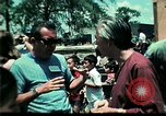 Image of Clown entertains Vietnamese refugee children Florida United States USA, 1975, second 62 stock footage video 65675050952
