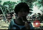 Image of Vietnamese refugee children play Florida United States USA, 1975, second 22 stock footage video 65675050953