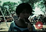 Image of Vietnamese refugee children play Florida United States USA, 1975, second 23 stock footage video 65675050953