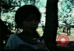 Image of Vietnamese refugee children play Florida United States USA, 1975, second 28 stock footage video 65675050953